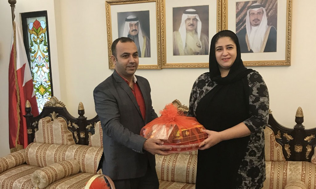 Officials from BLS International and Deputy Ambassador of Bahrain